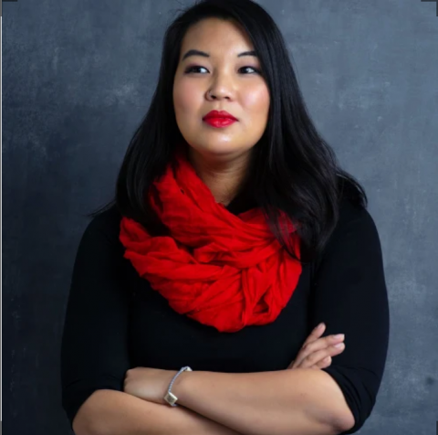 Headshot of Jessica Hobson, Asian woman with black top and red scarf